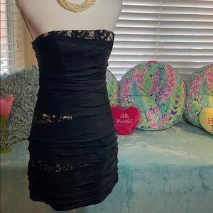 bebe black strapless dress w/distressed edges